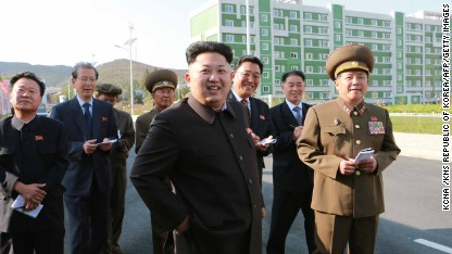 This undated picture released from North Korea's official Korean Central News Agency (KCNA) on October 14, 2014 shows North Korean leader Kim Jong-Un (C) smiling as he inspects a newly-built housing complex in Pyongyang. Kim Jong-Un has finally resurfaced with the help of a walking stick after a prolonged, unexplained absence that fuelled rampant speculation about his health and even rumours of a coup in the nuclear-armed state. AFP PHOTO / KCNA via KNS REPUBLIC OF KOREA OUT THIS PICTURE WAS MADE AVAILABLE BY A THIRD PARTY. AFP CAN NOT INDEPENDENTLY VERIFY THE AUTHENTICITY, LOCATION, DATE AND CONTENT OF THIS IMAGE. THIS PHOTO IS DISTRIBUTED EXACTLY AS RECEIVED BY AFP. ---EDITORS NOTE--- RESTRICTED TO EDITORIAL USE - MANDATORY CREDIT