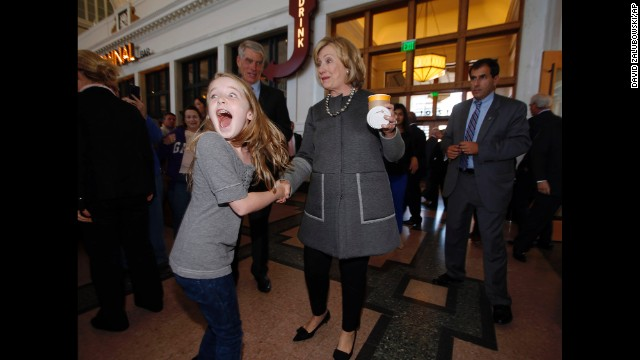 Clinton makes 10-year-old Macy Friday's day as she campaigns for U.S. Sen. Mark Udall during a stop Monday, October 13, in Union Station in Denver.