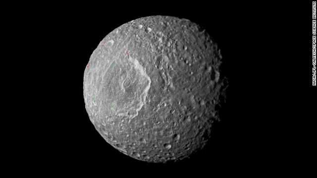 This mosaic of Saturn's moon Mimas was created from images taken by NASA's Cassini spacecraft in February 2010. A new study indicates the moon may contain a liquid water ocean. Click through to see more Cassini images of Saturn and its moons.