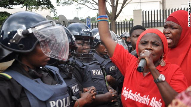 Police in riot gear block a route in Abuja on October 14, during a demonstration calling on the Nigerian government to rescue schoolgirls kidnapped by Boko Haram. In April, more than 200 girls were abducted from their boarding school in northeastern Nigeria, officials and witnesses said.