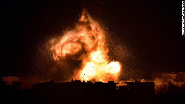 Flames rise over Kobani, Syia on October 18.
