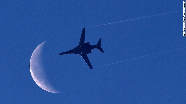 A U.S. Air Force plane flies above Kobani on Saturday, October