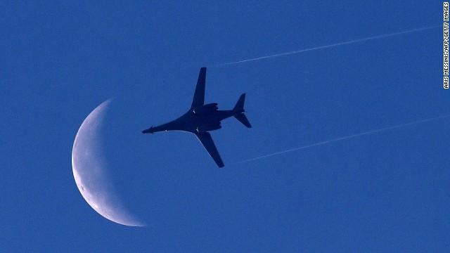 A U.S. Air Force plane flies above Kobani on Saturday, October 18.