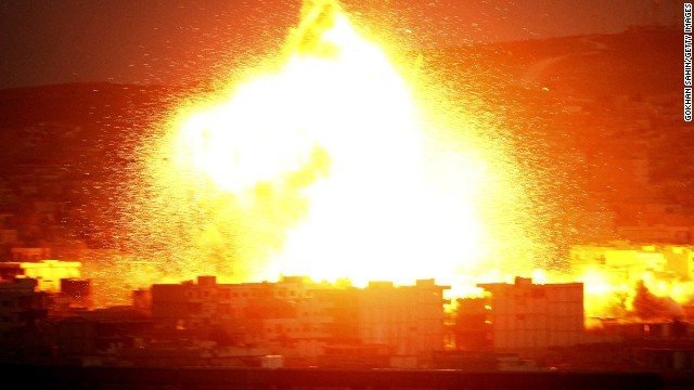 An explosion lights up the sky over Kobani, Syria during an airstrike on October 18.