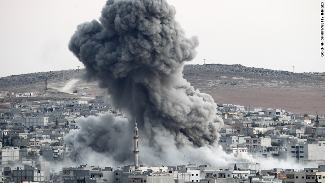 Heavy smoke rises following an airstrike by the U.S.-led coalition aircraft in Kobani, Syria, during fighting between Syrian Kurds and ISIS fighters, as seen from the outskirts of Suruc, on the Turkey-Syria border, on Saturday, October 18. Civil war has destabilized Syria and created an opening for the militant group, which also is advancing in Iraq as it seeks to create an Islamic caliphate in the region.