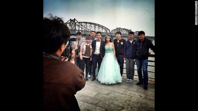 "DANDONG, CHINA: A wedding party is photographed beside the Yalu River in Dandong. Dandong lies opposite the North Korean city of Sinuiju, & is a main conduit for trade between the countries."" - CNN's Charlie Miller. Follow Charlie (@cnncharlie) and other CNNers along on Instagram at instagram.com/cnn."