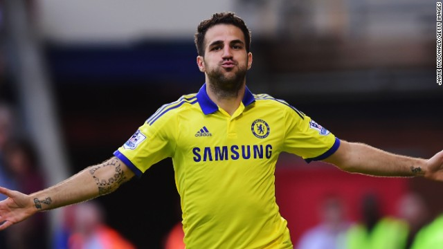 Cesc Fabregas celebrates his second half strike for Chelsea in a 2-1 win over Crystal Palace to stay top of the EPL.