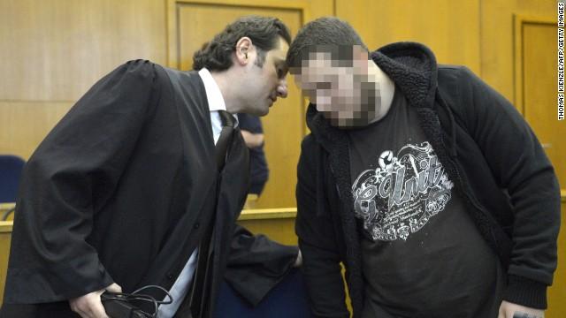 German alleged jihadist Kreshnik B (R) listens to his lawyer Mutlu Guenal (L) as he arrives at the higher regional court in Frankfurt. His face is pixelated for legal reasons.
