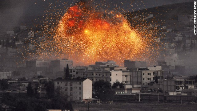 An explosion rocks Kobani, Syria, during a reported car-bomb attack by ISIS militants on Monday, October 20. Civil war has destabilized Syria and created an opening for the militant group, which is also advancing in Iraq as it seeks to create an Islamic caliphate in the region. Also on October 20, ISIS launched about 15 near-simultaneous attacks on Kurdish forces in northern Iraq.