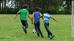 Young refugees from Syria play football in the grounds of the Hogar San Jose, a Catholic home on the outskirts of the capital, Montevideo.