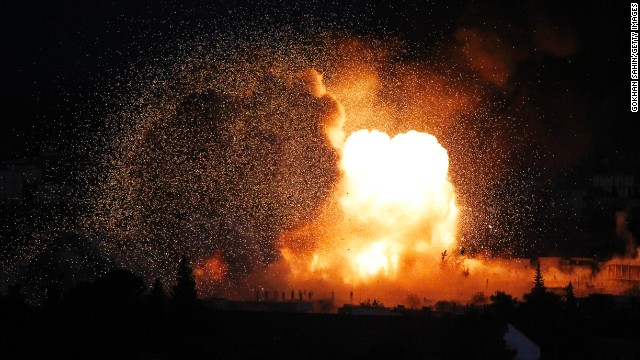 An explosion rocks Kobani during a reported car-bomb attack by ISIS militants on Monday, October