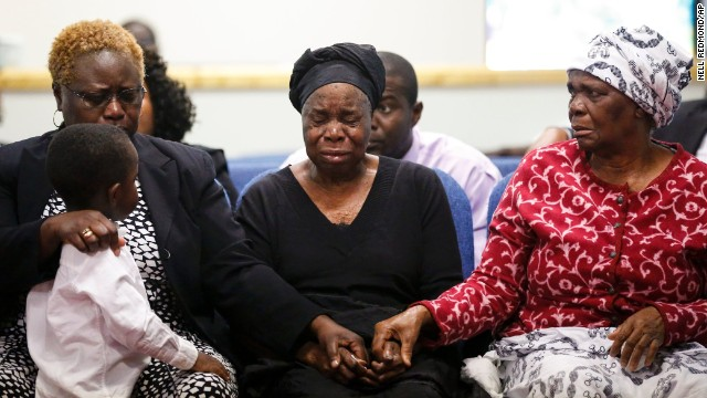 Garteh Korkoryah, center, is comforted during a memorial service for her son, Thomas Eric Duncan, on Saturday, October 18, in Salisbury, North Carolina. Duncan, a 42-year-old Liberian citizen, died October 8 in a Dallas hospital. He was in the country to visit his son and his son's mother.