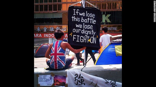 "HONG KONG: ""This 21 year old has been protesting for 16 days - eating, sleeping, and quietly holding this sign."" - CNN's Elizabeth Joseph, October 21. Follow Elizabeth (<a href='http://instagram.com/ejo1224' target='_blank'>@ejo1224</a>) and other CNNers along on Instagram at <a href='http://instagram.com/cnn' target='_blank'>instagram.com/cnn</a>."