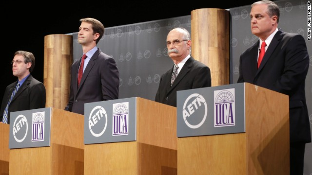 From left, Libertarian Party candidate Nathan LaFrance, Cotton, Green Party candidate Mark H. Swaney and Pryor listen to a question during a debate at the University of Central Arkansas.