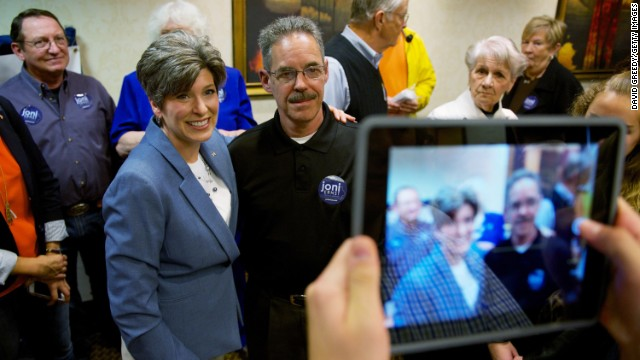 Ernst poses with supporters during a campaign rally in Cedar Rapids last month.