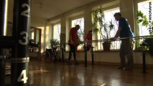 Paralyzed man 'reborn' with new treatment