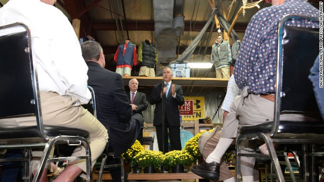 Tillis, flanked by U.S. Sen. John McCain, speaks at Neuse Sport Shop during a campaign stop in Kinston last month.