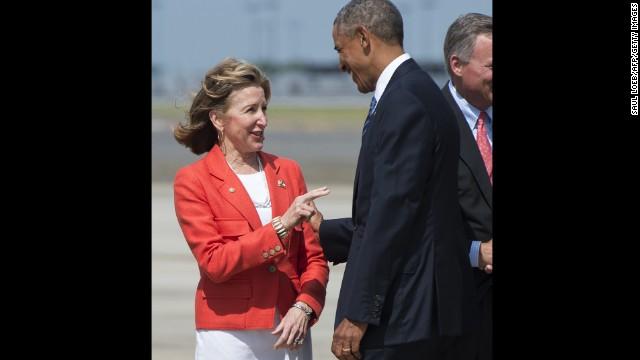 President Barack Obama greets Hagan after arriving in Charlotte in August.