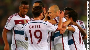 Bayern's Arjen Robben is mobbed by his teammates after scori9ng the opening goal against AS Roma in the Italian capital.