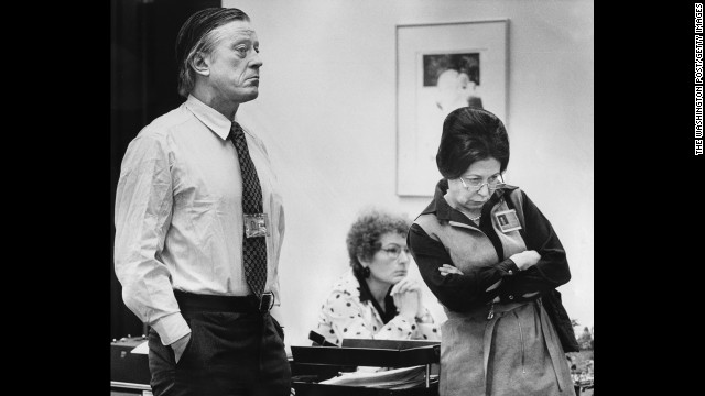 Bradlee and Deputy Editorial Page Editor Meg Greenfield, right, listen with another staff member to a statement being read by Post Publisher Katharine Graham during the 1975 press strike at the newspaper.
