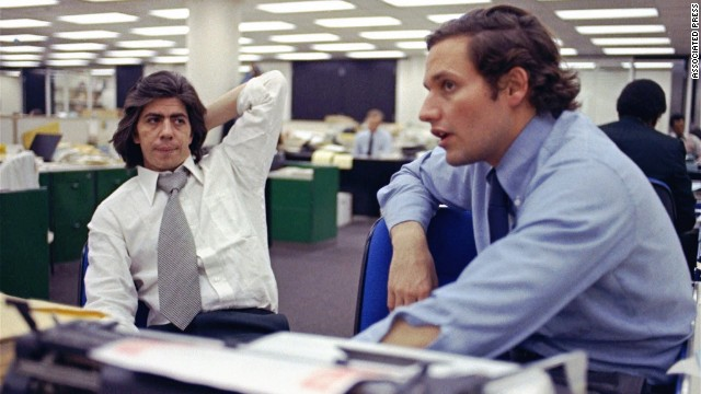 Reporters Carl Bernstein, left, and Bob Woodward in the newsroom in 1973, during the Washington Post's ongoing coverage of what became known simply as Watergate.