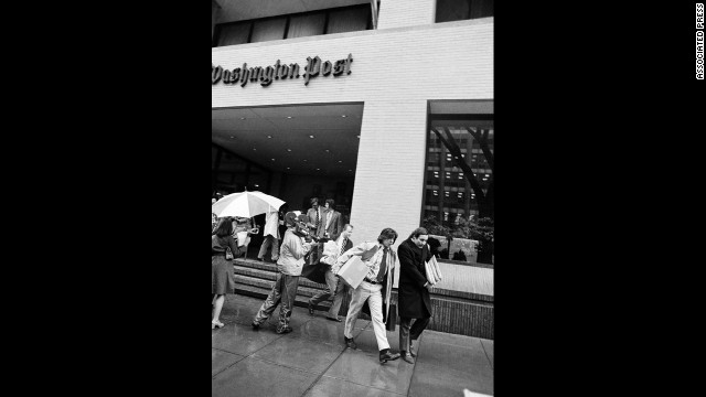 Bernstein, left, and Woodward, along with other editorial employees, walk off the job at the Post in Washington, April 8, 1974, after the local arm of the American Newspaper Guild went on strike against the paper.