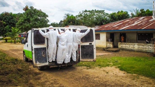 Health workers transport the body of a person suspected to have died of Ebola in Port Loko, Sierra Leone, on Tuesday, October 21. Health officials say the Ebola outbreak in West Africa is the deadliest ever. More than 4,500 people have died there, according to the World Health Organization.