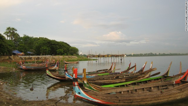 Colorful boats dock along the banks of Taungthaman Lake near Amarapura, Myanmar. Locals from nearby villages use these boats to commute to work daily.