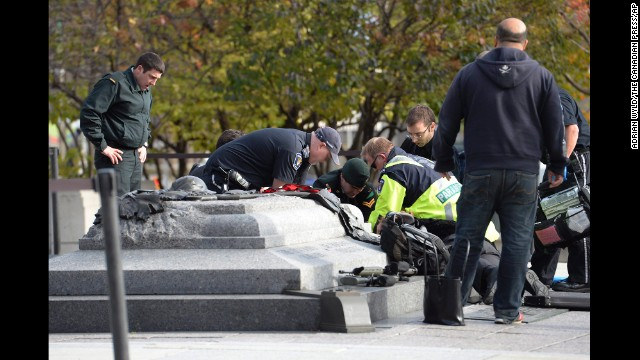 Emergency personnel tend to a person who was shot at the National War Memorial. A Canadian soldier was shot and killed as he and another soldier stood guard at the memorial, police said.