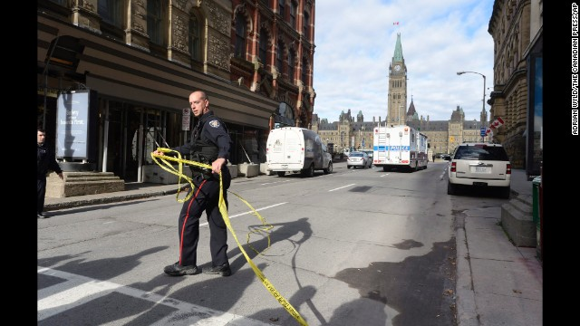 Police cordon off a street leading to Parliament Hill.