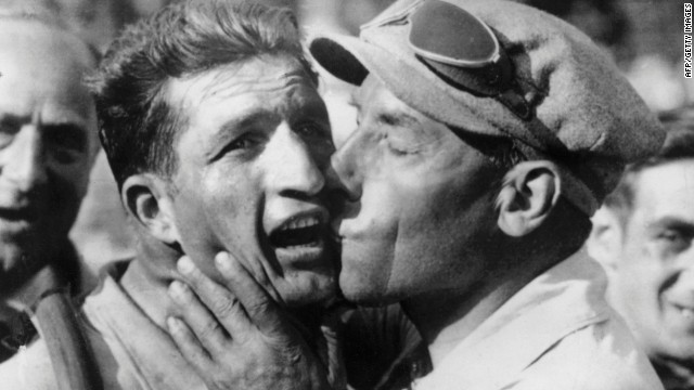 Bartali is congratulated by his team sports director Costante Girardengo after winning on July 18, 1938, the 11th stage of the Tour de France between Montpellier and Marseille.