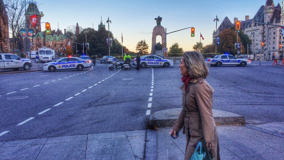 """OTTAWA, CANADA: A woman walks near the National War Memorial in the nation's capital. Yesterday a gunman opened fire there, killing Canadian army reservist, Cpl. Nathan Cirillo. The gunman then entered the nearby main Parliament building, where witnesses say shots were fired -- many by security officers -- before he was shot dead, authorities said. The gunman was Quebec native Michael Zehaf-Bibeau, a convert to Islam, U.S. officials told CNN, citing information given to them by Canadian authorities. Canadian investigators haven't provided any possible motives for the shooting. A U.S. law enforcement official told CNN that a connection to terrorism hasn't been ruled out. The shootings left government workers and others locked inside offices for a large portion of the day while police searched buildings to ensure that no other culprit was loose. Wednesday's deadly attack was the second on Canadian soldiers this week. On Monday, a convert to Islam who Canadian authorities said was """"radicalized"""" hit two soldiers with a car in Quebec, killing one of them. Police later killed the man. Photo by CNN's Khalil Abdallah, October 23. Follow Khalil (<a href='http://instagram.com/madcameraman' target='_blank'>@madcameraman</a>) and other CNNers along on Instagram at <a href='http://instagram.com/cnn' target='_blank'>instagram.com/cnn</a>."""