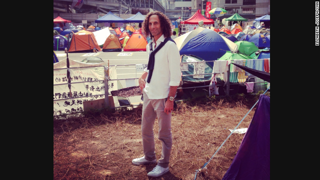 CNN's Elizabeth Joseph saw jazz musician Kenny G walking around the Hong Kong protest site on October 22 and took this photo, which quickly went viral. The musician also took a selfie, which has since been deleted.