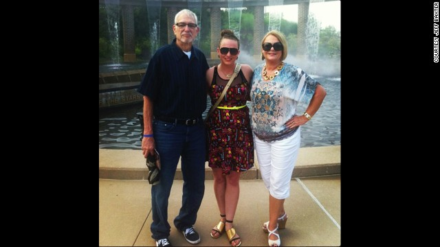 Baxter stands with his family on Father's Day 2013, 270 pounds lighter than he was two years before.