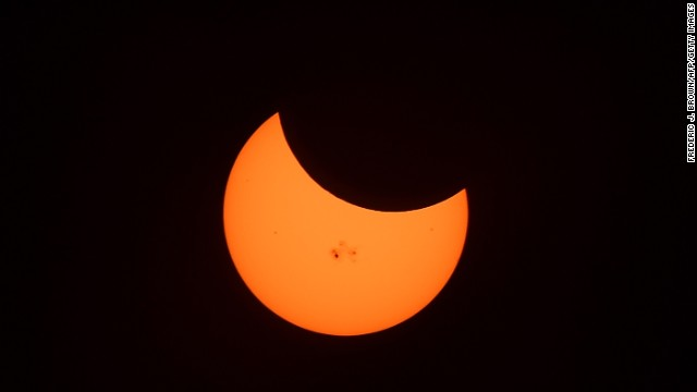Sunspots are seen during the peak moment of the solar eclipse when the moon was covering 34% of the sun.