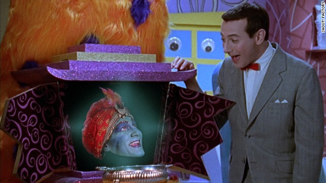 """Mecka-lecka hi, Mecka-hiney ho!"" Jambi was the Playhouse's genie-in-residence. John Paragon, or rather, his disembodied head, played Jambi. He was also a writer on the series."