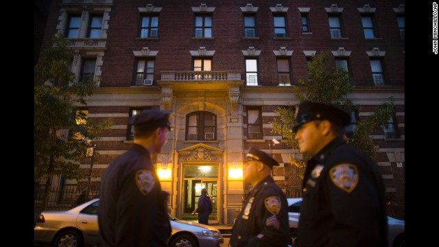 Police officers on Thursday, October 23, stand outside the New York City apartment of Craig Spencer, a Doctors Without Borders physician who recently returned from West Africa and tested positive for Ebola.