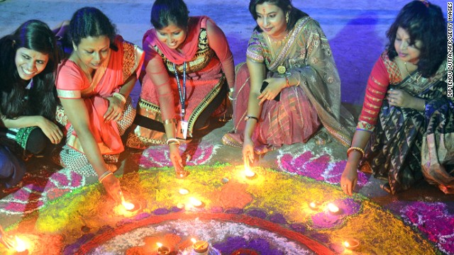 Indian women pose with earthen lamps ahead of Diwali, the Hindu festival of lights, in Siliguri on October 19.