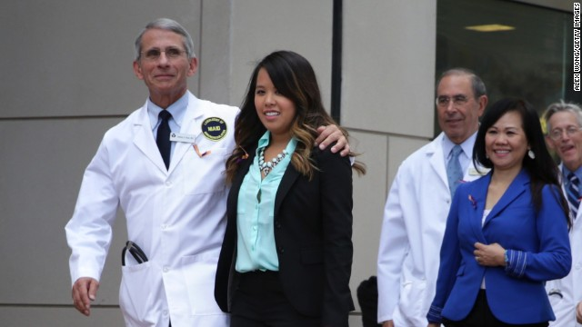 Anthony Fauci, director of the National Institute of Allergy and Infectious Diseases, puts his arm around Nina Pham, one of the two Texas nurses diagnosed with Ebola, before a news conference Friday, October 24, in Bethesda, Maryland. Pham was declared Ebola-free after being treated at a National Institutes of Health hospital in Bethesda.