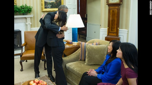 U.S. President Barack Obama hugs Ebola survivor Nina Pham in the Oval Office of the White House on Friday, October 24. Pham, one of two Texas nurses who were diagnosed with the virus, was declared Ebola-free after being treated at a hospital in Bethesda.