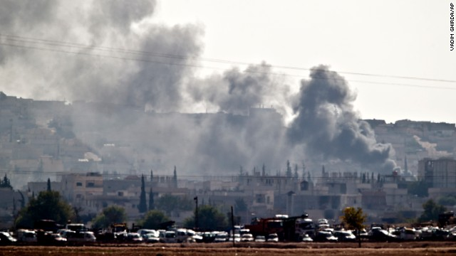 Smoke rises during fighting in the Syrian city of Kobani, seen from the outskirts of Suruc, Turkey, on Saturday, October 25. The United States and several Arab nations have been bombing ISIS targets in Syria to take out the militant group's ability to command, train and resupply its fighters.