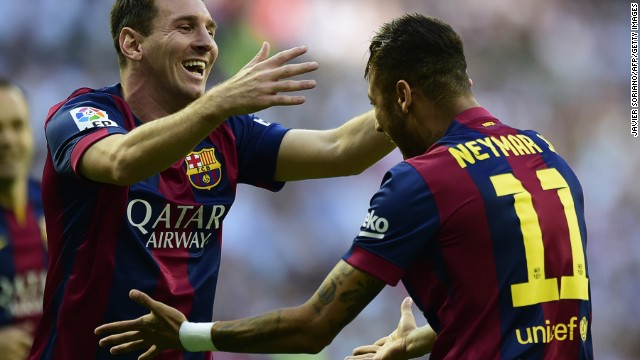 Lionel Messi (left) congratulates his teammate Neymar. The Brazilian striker opened the scoring for Barcelona in the 4th minute against Real Madrid at the Bernabeu on Saturday.