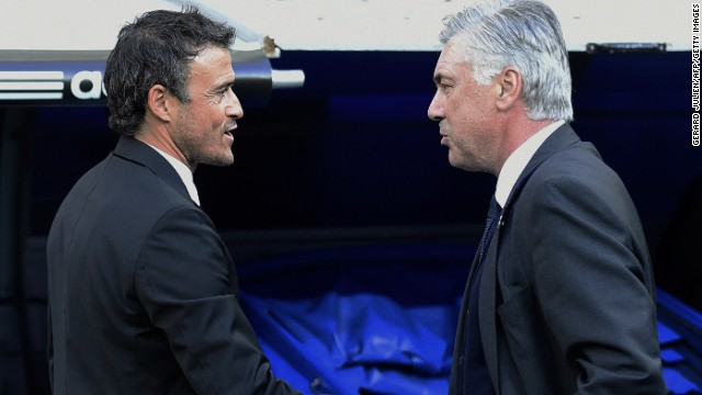 Barcelona coach Luis Enrique (left) talks with Real Madrid's Italian coach Carlo Ancelotti before the match.