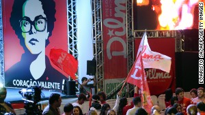 Supporters of Dilma Rousseff celebrate following the first partial results in the run-off election.