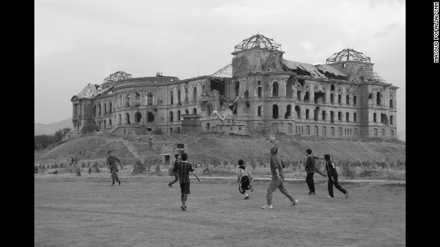 "KABUL, AFGHANISTAN: Children playing football in front of Darul-Aman Palace. It's name means ""Abode of Peace,"" but the Darul-Aman Palace outside Kabul symbolizes the years of war and strife that have ravaged this city. A massive monument built in the 1920's by King Amunullah Khan, who tried and failed to reform Afghanistan, it was left empty for years, before being successively destroyed by fire, turned into a museum, used as a defence ministry and shelled by the Mujahideen after the Soviets left. Photo by CNN's Masoud Popalzai. Follow Masoud (@masoudpopalzai) and other CNNers along on Instagram at instagram.com/cnn."