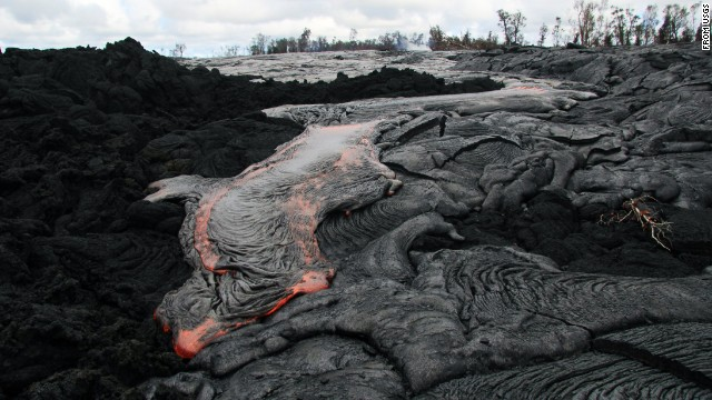 Lava flows from the Kilauea volcano October 3 in Pahoa, Hawaii. The flow has recently picked up speed, prompting emergency officials to close part of the main road through town and tell residents to be prepared to evacuate.
