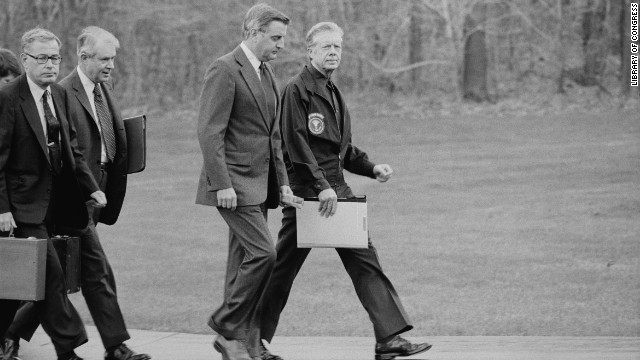 From right, President Jimmy Carter, Vice President Walter Mondale, Secretary of State Cyrus Vance and Secretary of Defense Harold Brown disembark from their helicopter to meet about the Iran hostage crisis at Camp David in Maryland on November 23, 1979. President Carter ordered Iranian assets in U.S. banks frozen and eventually cut diplomatic ties with Iran.