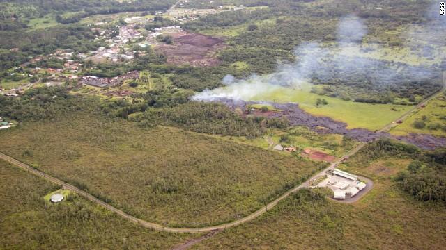 Smoke rises near Apa'a Street and Pahoa Village Road in Pahoa, Hawaii, on Monday, October 27.
