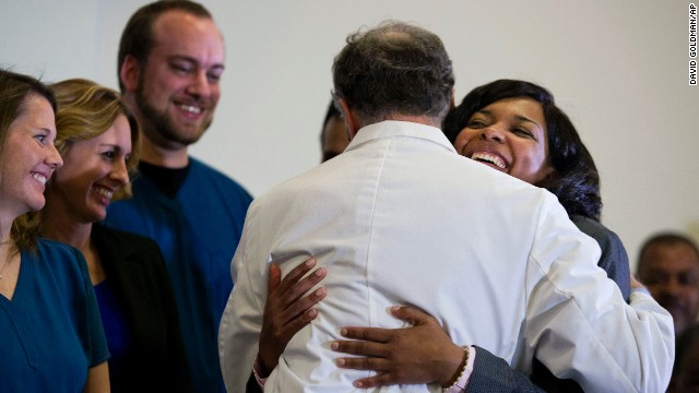 Amber Vinson, one of the two Dallas nurses who were diagnosed with Ebola, embraces Emory University Hospital epidemiologist Dr. Bruce Ribner after being discharged from the Atlanta hospital on Tuesday, October 28. Vinson and the other nurse, Nina Pham, have both been declared Ebola-free.