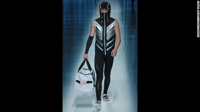 The QIAODAN Yin Peng Sports Wear Collection show included fashions and masks for both men and women.